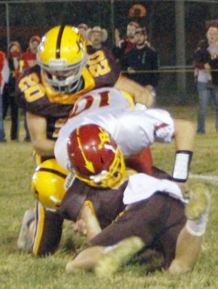 STERLING'S SAM BOLDT (12) AND GARRETT HIER (20) tackle this Red Cloud opponent on their first drive of the night.