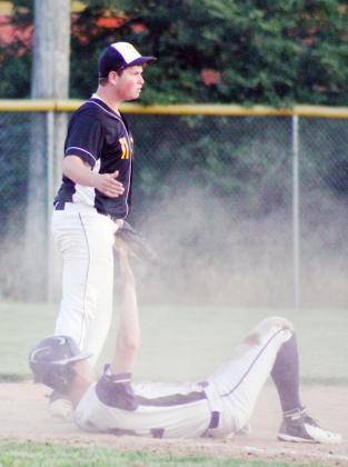 TANNER KERNER waits for the umpire to make the call as a Louisville/Weeping Water player is tagged out at third base.