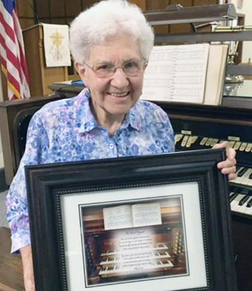 "GRACE BENTZINGER was honored by Grace Lutheran Church of Cook for playing the organ there for 70 years. Her plaque reads: ""The Church Organist/ The role of the organist is most sacred,/ To provide music in the house of the Lord;/ To set the right tone for the worship service,/ And to bring hearts in one accord.// The Spirit is the One who should guide,/ In the selection of hymns to play,/ So that those who come to worship,/ Will feel blessed at the end of the day./ -Hillary Ascalon"""